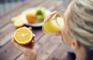 woman-drinking-fresh-orange-juice